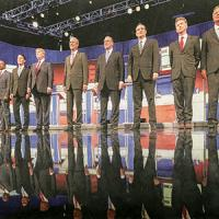 Ten Republicans running for president in 2016 stand on stage before a debate.