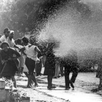 Children's Crusade protesters are sprayed by firehoses.
