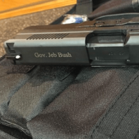 "Tweet by Jeb Bush, picture of a handgun with the caption ""America"""