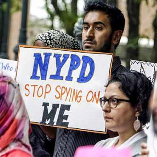 People rally in Manhattan, NY, to protest a New York Police Department surveillance program.