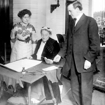 Abigail Scott Duniway signs Oregon's Equal Suffrage Proclamation in a ceremony on Nov. 30, 1912,