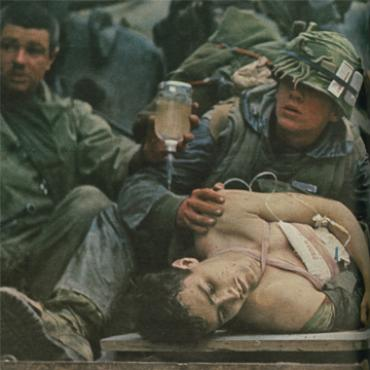 John Olson photo of wounded Marine in Vietnam