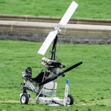 A gyrocopter lands on the Capitol grounds.