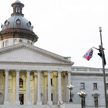 Bree Newsome takes down the Confederate flag in front of the South Carolina state house.
