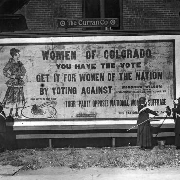 Suffragists With Anti-Woodrow Wilson Billboard, 1916