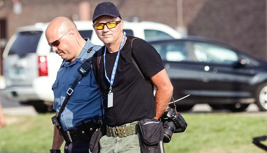 Police arrest Getty Images photographer Scott Olson in Ferguson, Mo., on Aug. 18, 2014.