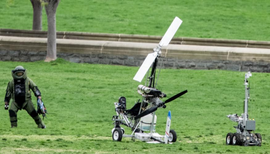 A member of the bomb squad inspects the gyrocopter.