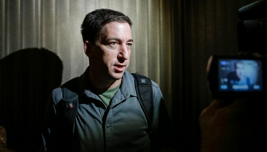 Reporter Glenn Greenwald speaks with the press in Hong Kong.