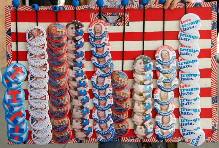 A vendor sells pins to supporters of Democratic contender Hillary Clinton at a May 26, 2016, rally in San Jose, Calif., shortly before that state's primary.